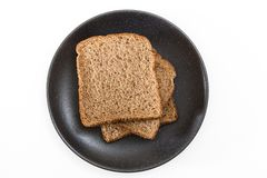 Whole grain sandwich bread slices on plate, on white background. Whole grain sandwich bread slices on plate, on white background Stock Image