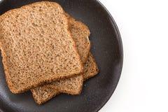 Whole grain sandwich bread slices on plate, on white background. Whole grain sandwich bread slices on plate, on white background Royalty Free Stock Photos
