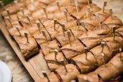 Whole grain sandwichs ( canape ) with Italian salami, goat chees Stock Photo