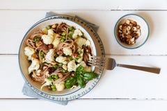 Whole-grain-spaghetti with roasted cauliflower, hazelnuts Royalty Free Stock Images