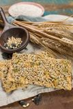Whole grain wheat flour, sunflowers seeds and fresh baked cracke. Whole grain wheat flour, sunflowers seeds and healthy fresh baked crackers close up Stock Image