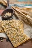 Whole grain wheat flour, sunflowers seeds and fresh baked cracke. Whole grain wheat flour, sunflowers seeds and healthy fresh baked crackers close up Stock Photos