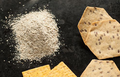 Whole grain yellow and brown organic cracker and flour Stock Images