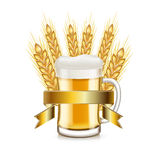 Whole grains and beer glass with golden ribbon  Stock Photo