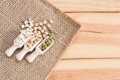 Whole Grains In Wood Scoop On Wooden Table. Stock Photo