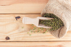 Whole Grains In Wood Scoop On Wooden Table. Stock Photos