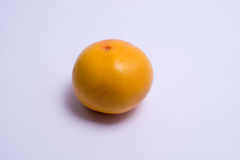 Whole grapefruit isolated on white. Whole grapefruit isolated on a white background Royalty Free Stock Photo