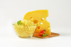 Whole and grated cheese Royalty Free Stock Photo