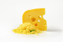 Whole and grated cheese Royalty Free Stock Photos