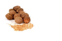 Whole and grated nutmeg. Isolated on white Royalty Free Stock Photography