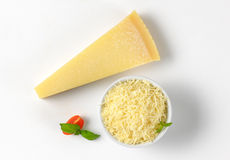 Whole and grated parmesan cheese Royalty Free Stock Photos