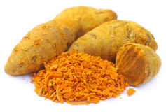 Whole and grated turmeric Royalty Free Stock Image