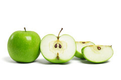 Whole green apple and cut pieces Royalty Free Stock Photo