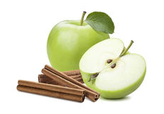 Whole green apple and half plus cinnamon stick isolated. On white background as package design element stock photography