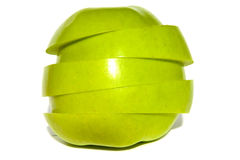 Whole Green Apple in Sections. A whole yellow green apple sliced and put back together Stock Photography