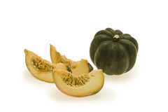 Whole green gourd and pumpkin slices. On a white background Stock Photo