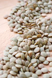 Whole green lentils. Whole green lentil close up royalty free stock photo