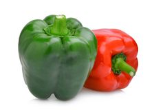 Whole of green and red sweet bell pepper or capsicum. On white background stock images