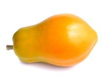 Whole green yellow papaya fruit Stock Image