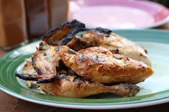 Whole grilled chicken on plate Royalty Free Stock Photo