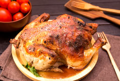 Whole grilled chicken Stock Images