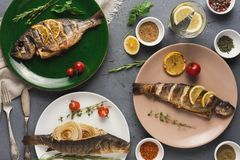 Free Whole Grilled Dorado And Sea Bass On Table Stock Image - 108654731