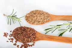 Whole and ground brown flax seeds or linseeds Stock Images