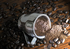 Whole and ground coffee beans. A background of whole and ground coffee beans Stock Photos