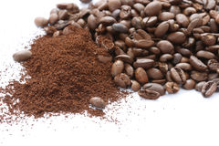 Whole and ground coffee beans. Scattered on white background Stock Photography