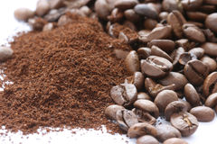 Whole and ground coffee beans scattered Stock Photo