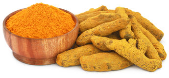 Whole and ground turmeric Stock Images