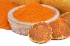 Whole and ground turmeric Royalty Free Stock Image