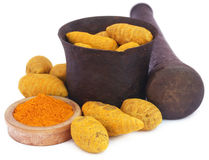 Whole and ground turmeric with mortar and pestle Royalty Free Stock Photography