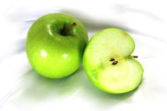 The whole and half apples. Royalty Free Stock Image