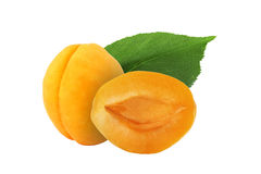 Whole and half apricot with leaf isolated on white. Background Stock Photo