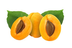 Whole and half apricot with stone and leaf isolated. On white background stock images