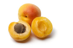 Whole and half apricots Stock Photos
