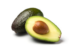 Whole/half avocado isolated Stock Images
