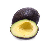 Whole and half avocado isolated on white. Royalty Free Stock Images