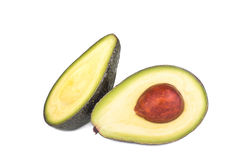 Whole and half avocado isolated on white. Background Royalty Free Stock Images