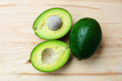 Whole and half avocado Stock Photo