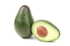 Whole and half avocados Royalty Free Stock Images