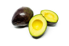 Whole and half avocados Royalty Free Stock Image