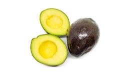 Whole and half avocados Royalty Free Stock Photos