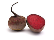 Whole and half beet root Stock Images