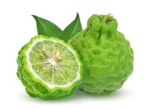 Whole and half bergamot fruit with leaf isolated on white. Background royalty free stock image