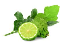 Whole and half bergamot with leaf isolated on white. Background royalty free stock photo