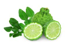 Whole and half bergamot with leaf isolated on white. Background royalty free stock image
