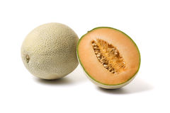 Whole, half cantaloupe melon royalty free stock photo