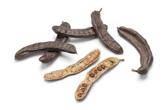 Whole and half Carob pods Royalty Free Stock Photo
